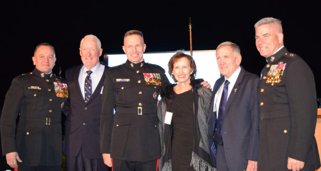 Group picture of LtGen Richard Mills USMC (Ret), Judge David O. Carter and his wife, Mary Ellen, and BGen Frank Quinlan USMC (Ret)