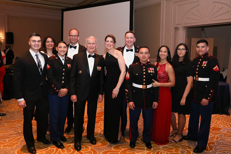 LtCol Oliver North, USMC (Ret) poses with Marines